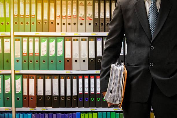 businessman holding data files stock photo