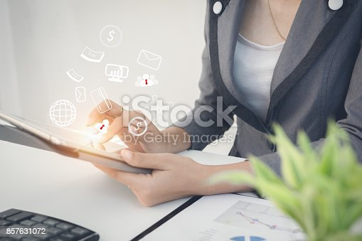 858031152istockphoto Businessman holding digital tablet at office on table with document graph data, Businesswoman calculate about cost, Finance managers task, Concept business and finance investment 857631072