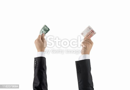 Businessmen hands in a row holding dollars and pound
