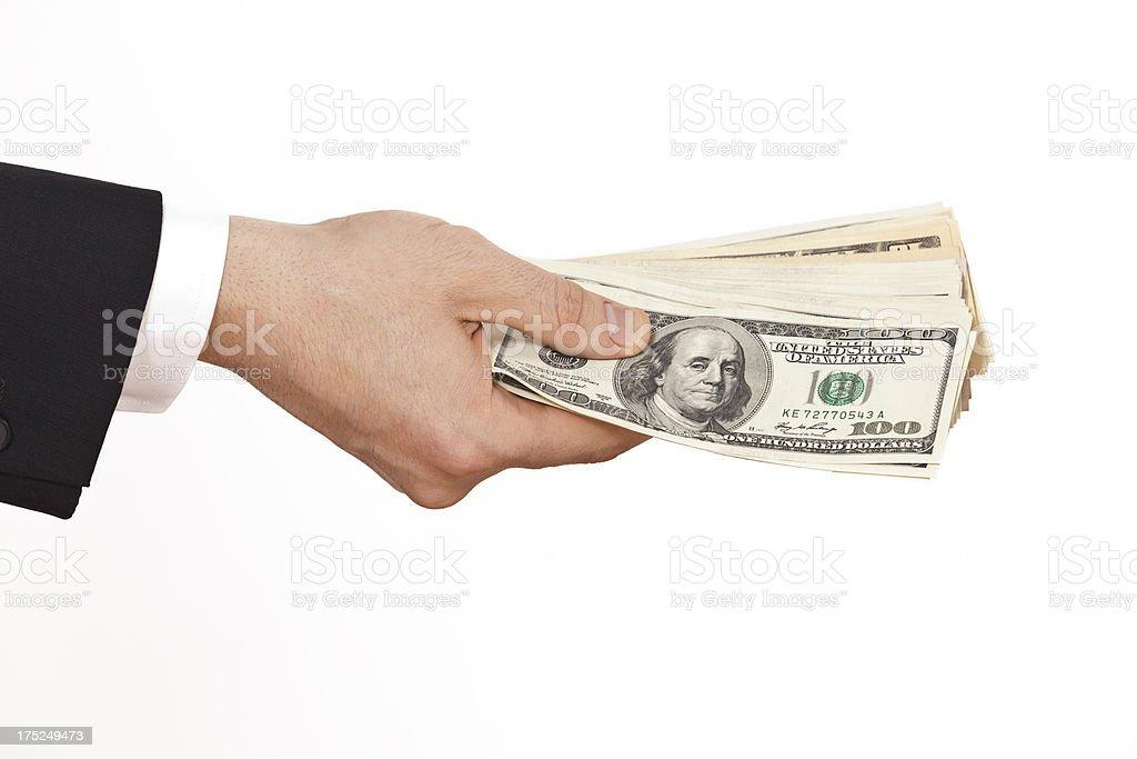 businessman holding dollars royalty-free stock photo
