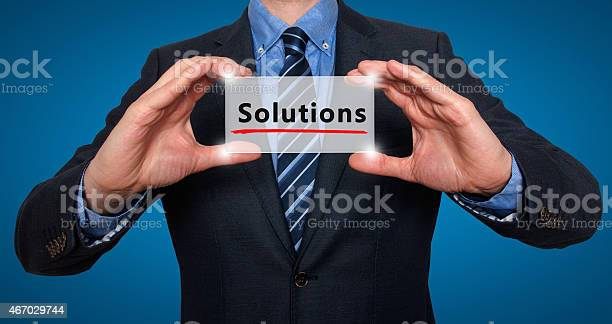 Businessman holding engraved solutions sign picture id467029744?b=1&k=6&m=467029744&s=612x612&h= wubaw9moav64 vbgrtcd5frc85m0hqvpvdvomfqkxq=