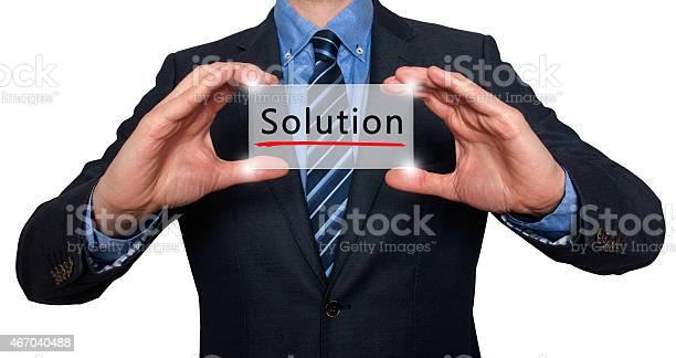 Businessman holding engraved solutions sign picture id467040488?b=1&k=6&m=467040488&s=612x612&h=ypprfi1r1yom3emx5lzwthgqgpwvukfov 1c5e0thzy=