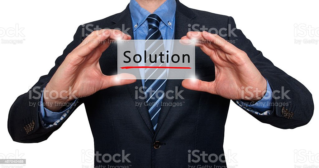Businessman holding engraved solutions sign. stock photo