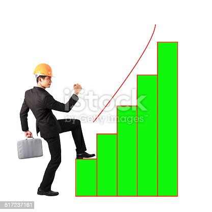 486678786 istock photo businessman holding files climbing on bar graph to success 517237161