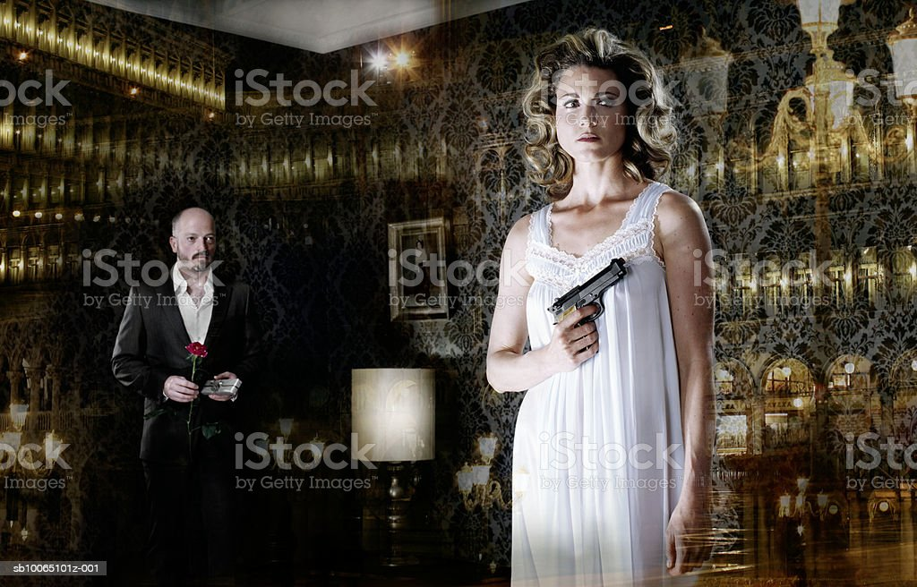 Businessman holding flower and looking at woman holding gun royalty free stockfoto