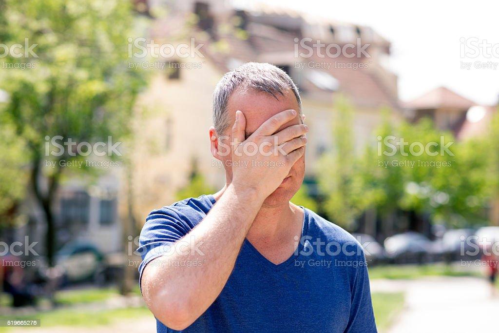 Businessman Holding Forehead to Relieve Headache stock photo