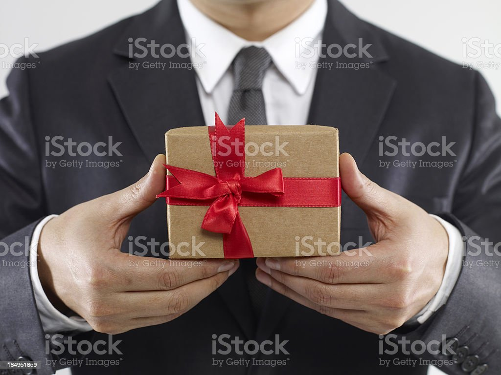 Businessman Holding Gift Box stock photo