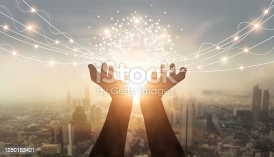 613550706 istock photo Businessman holding global network and data customer connection on city background, innovative technology in science and communication. 1250153421