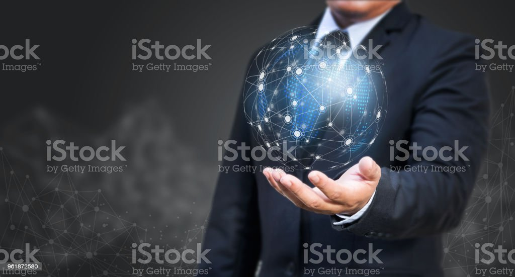 Businessman holding global network. Social media connection concept. stock photo