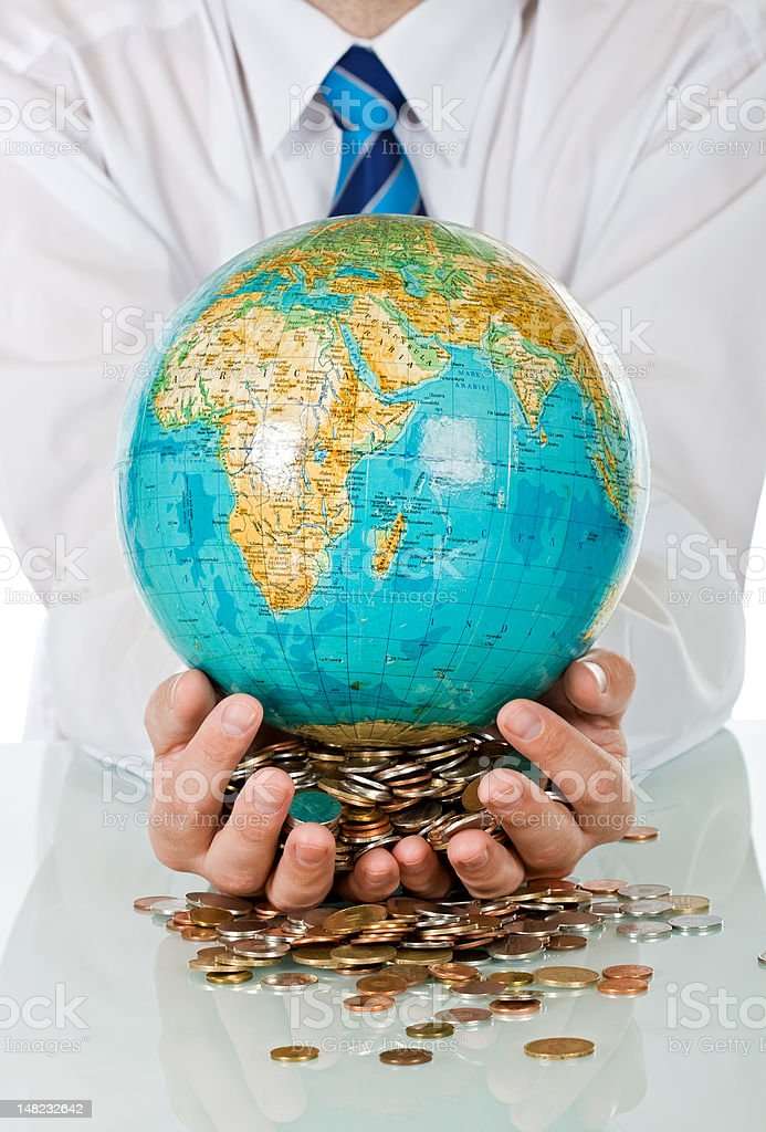 Businessman holding globe royalty-free stock photo