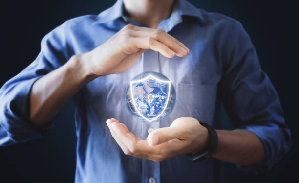 Businessman holding globe with protection shield icon. Saving earth, Energy saving and Security concept. Element of this image are furnished by NASA Businessman holding globe with protection shield icon. Saving earth, Energy saving and Security concept. Element of this image are furnished by NASA augmented reality sustainable stock pictures, royalty-free photos & images