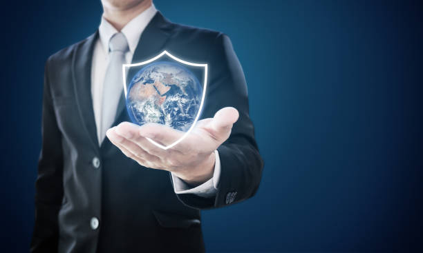 Businessman holding globe with shield icons. Protect the world and environmental conservation. Element of this image are furnished by NASA Businessman holding globe with shield icons. Protect the world and environmental conservation. Element of this image are furnished by NASA (https://svs.gsfc.nasa.gov/11650) augmented reality sustainable stock pictures, royalty-free photos & images