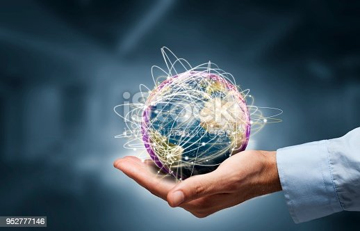 istock Businessman holding globe,Internet Concept of global business.Elements of this image furnished by NASA 952777146