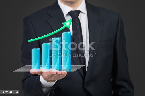 businessman holding stock graph with arrow