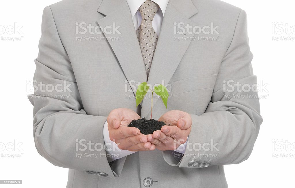 Businessman holding green plant isolated royalty-free stock photo