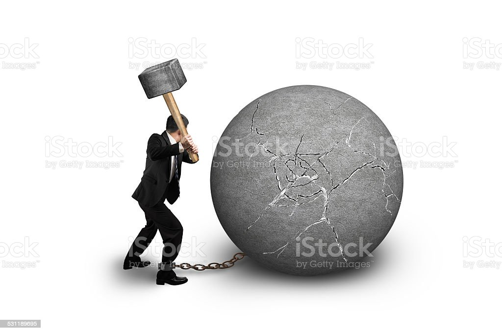 Businessman holding hammer hitting cracked concrete ball isolate stock photo