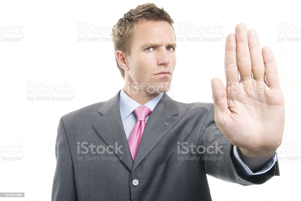 Businessman Holding Hand Out with Angry Expression Stop royalty-free stock photo