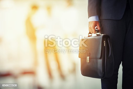 Businessman Holding His Briefcase In Office Stock Photo ...