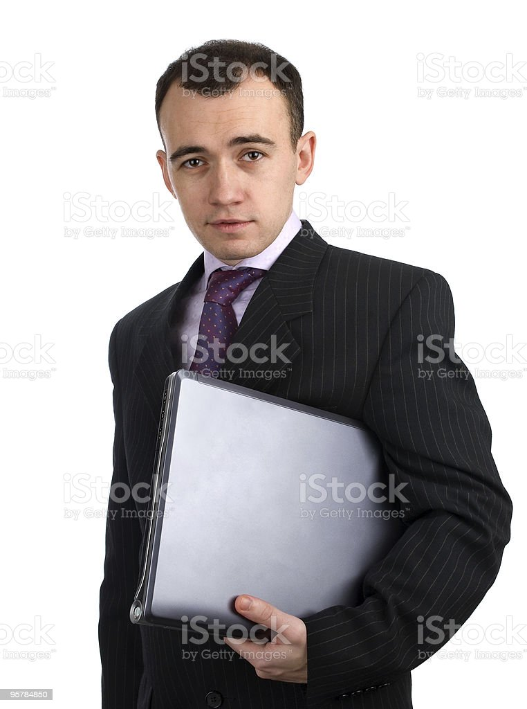businessman holding his laptop computer royalty-free stock photo