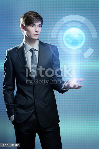 Businessman holding hologram of the earth in his hand