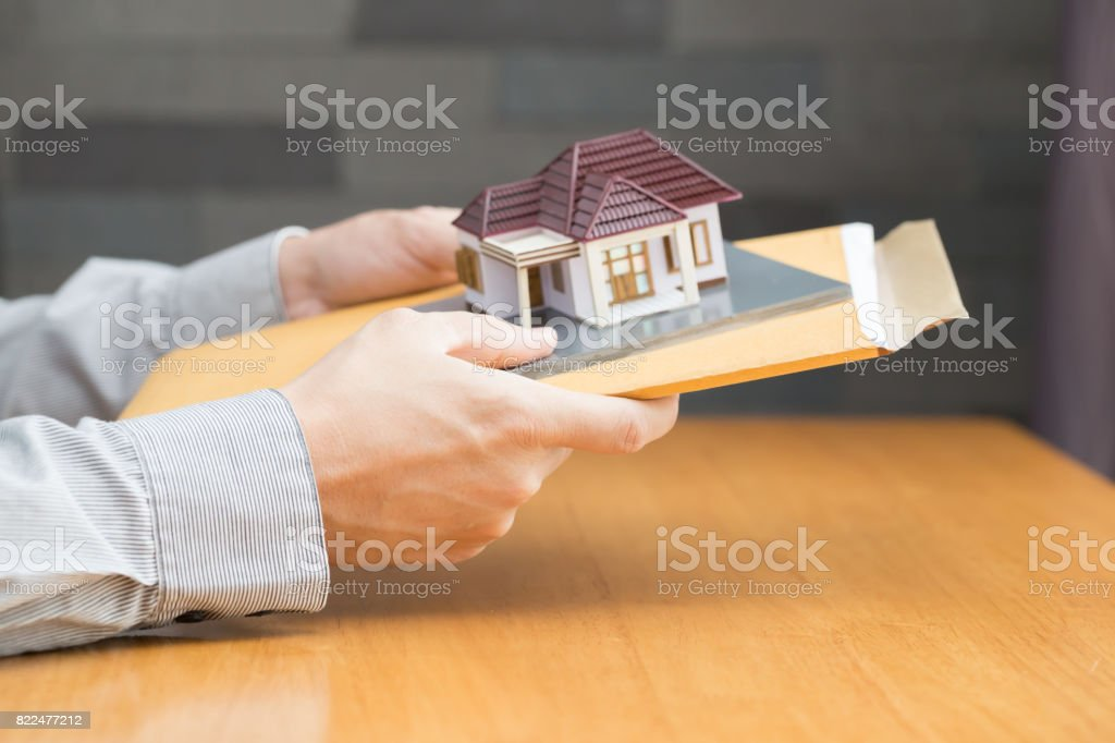 Businessman holding home loan application stock photo