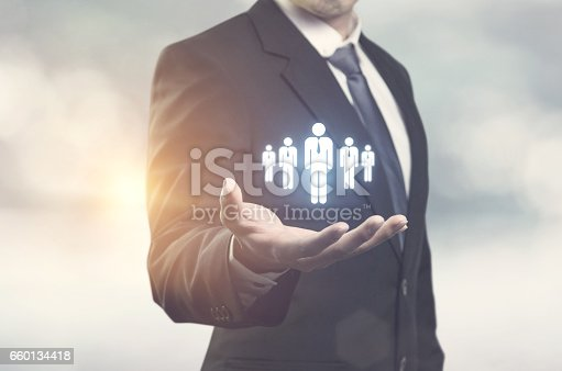 istock Businessman holding Human resources and customer care 660134418