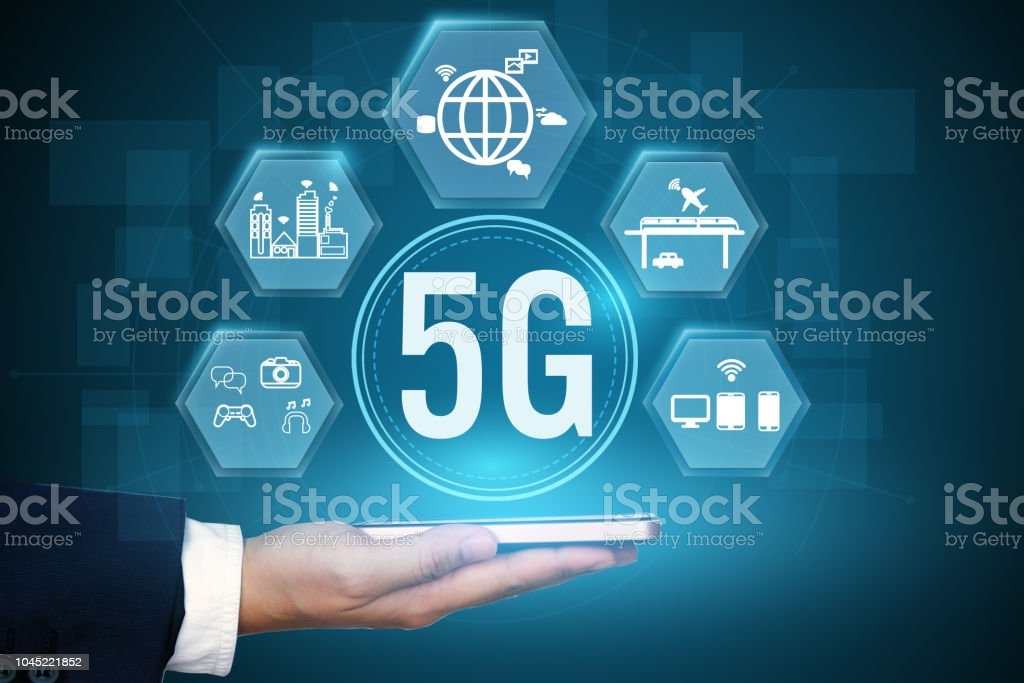 Businessman holding icon of 5g communication network systems. stock photo