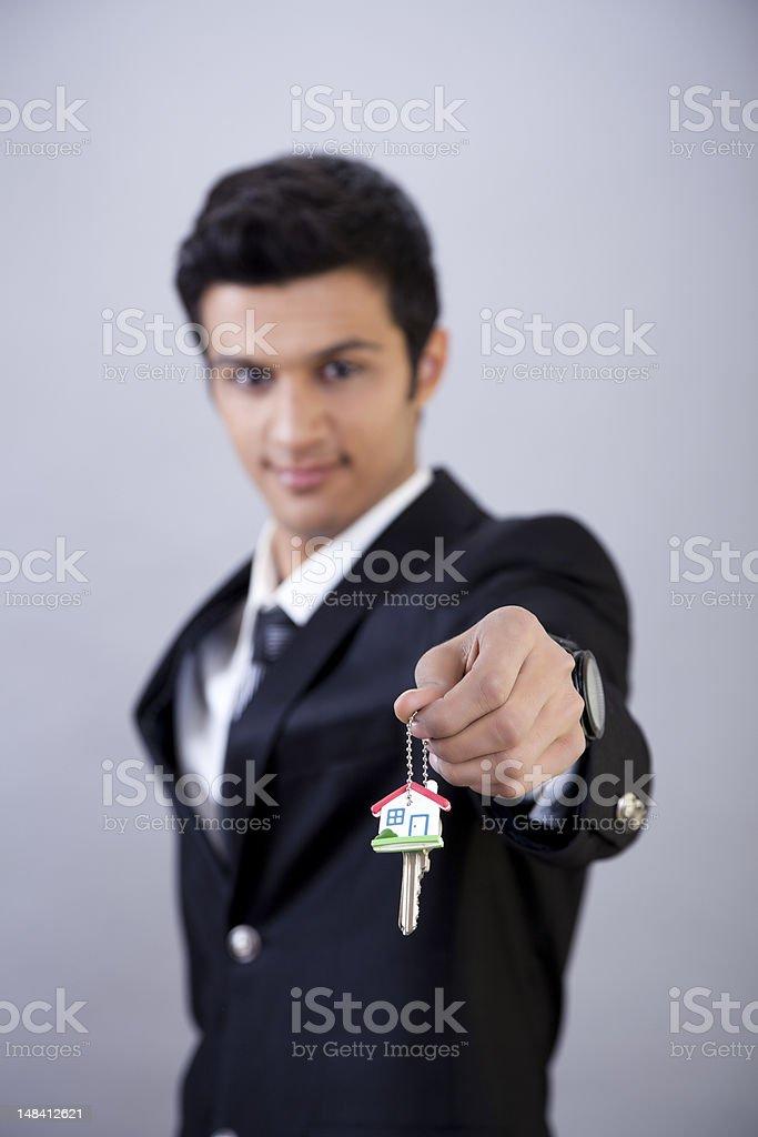 Businessman Holding Keys royalty-free stock photo