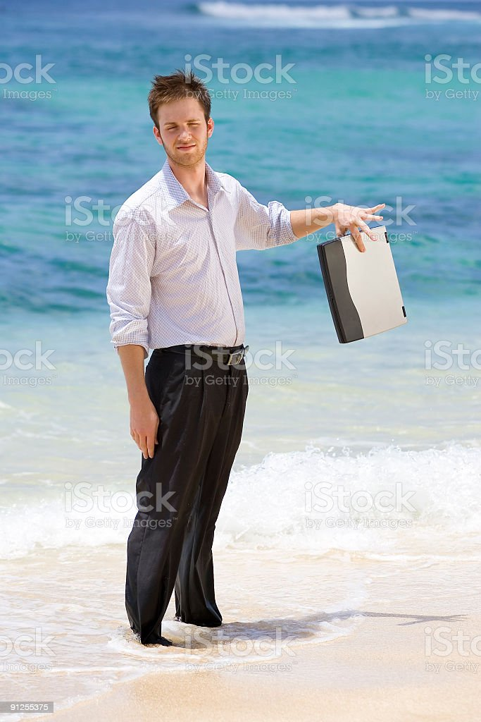 Businessman Holding Laptop on Beach royalty-free stock photo