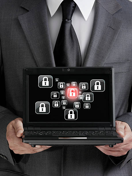 businessman holding laptop businessman holding laptop with firewall security icons on screen vpn stock pictures, royalty-free photos & images