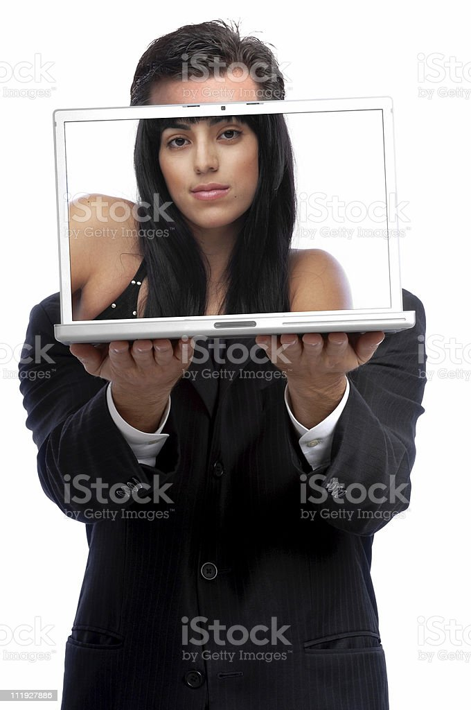 Businessman Holding Laptop with Woman in fronto of Face stock photo