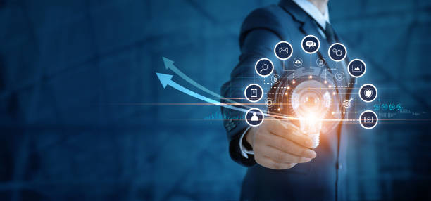 Businessman holding light bulb and analyzing sales data and economic growth graph. Technology and icon customer global network connection. New idea. creativity and inspiration. digital marketing. stock photo