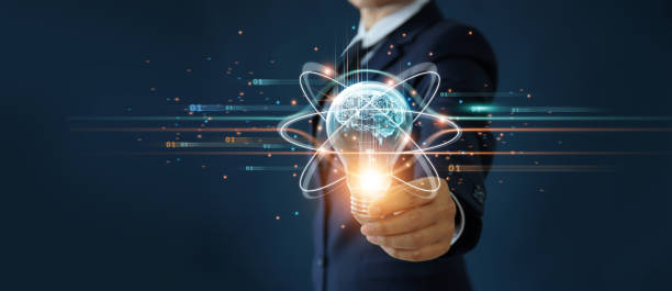 Businessman holding light bulb and brain inside, Idea and imagination, Creative and inspiration, Science innovation with network connection, Solution analysis and development, Innovative technology. stock photo