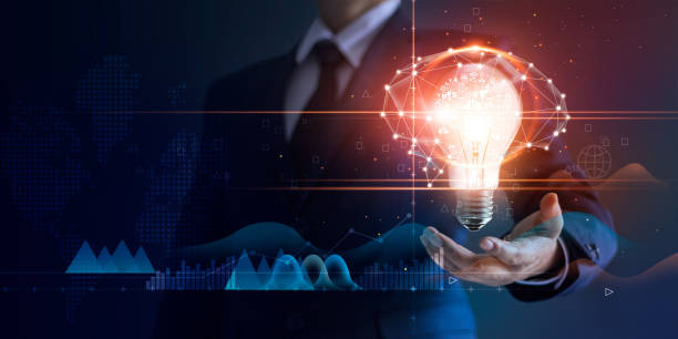 businessman holding light bulb and brain network with icon business and technology, innovative in futuristic, network connection on virtual interface background, abstract, innovation and business technologies concept. - active brain imagens e fotografias de stock