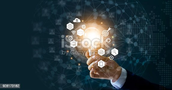 istock Businessman holding light bulb and new ideas of business with innovative technology network connection. Business innovation concept. 928173182