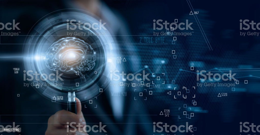 Businessman holding magnifying glass and digital brain, searching of a teamwork brainstrom for effective business stock photo