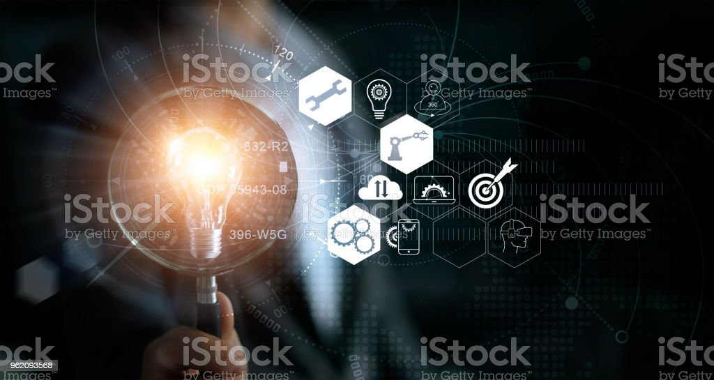 Businessman holding magnifying glass and light bulb. Idea and imagination. Creative and inspiration. Innovation icon network connection. Search engine optimisation. Innovative technology in science and industrial concept stock photo