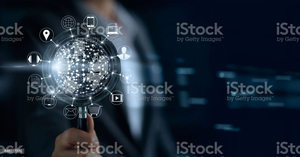 Businessman holding magnifying glass, search payments online shopping and icon customer network connection on screen, m-banking and omni channel stock photo