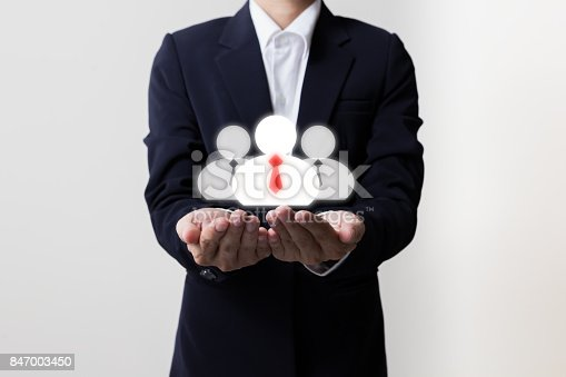 519831260 istock photo Businessman holding managers and team symbols, Teamwork concept 847003450