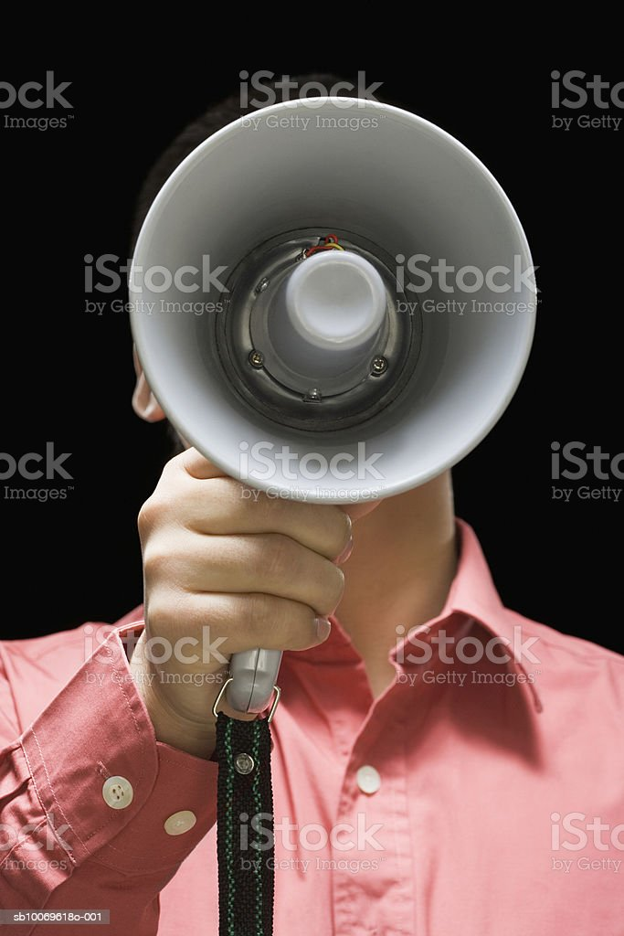 Businessman holding megaphone in front of his face Lizenzfreies stock-foto