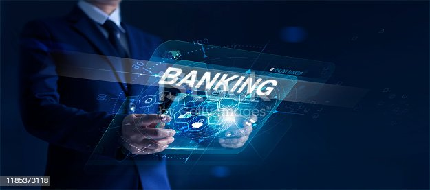 650662058istockphoto Businessman holding modern interface and word banking in hand with icon network connection on virtual screen dark background 1185373118