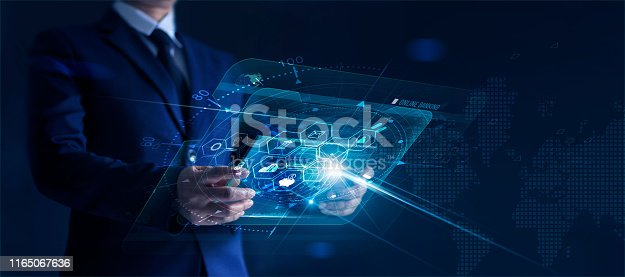 istock Businessman holding modern virtual interface banking in hand with icon network connection, shopping and mobile payment online 1165067636