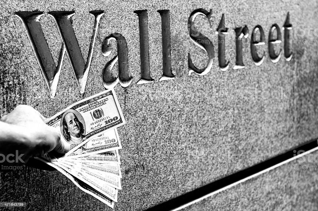 Businessman holding money, Wall Street, NYC. Black And White royalty-free stock photo