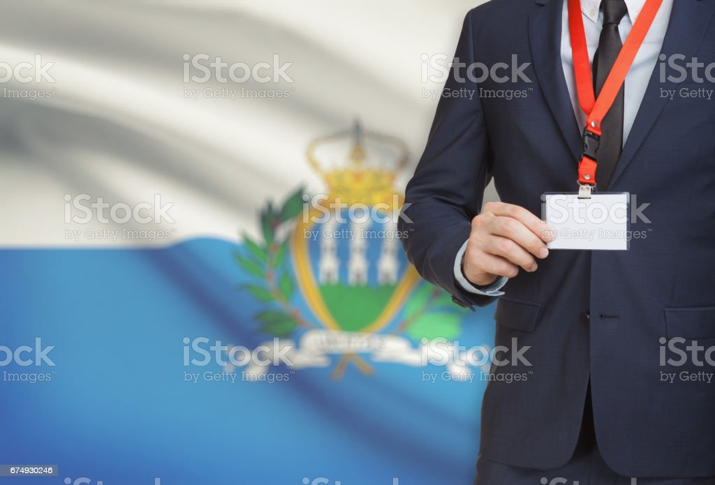 Businessman holding name card badge on a lanyard with a national flag on background - San Marino royalty-free stock photo
