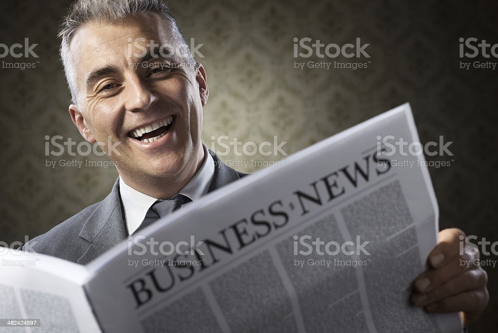Businessman holding newspaper stock photo