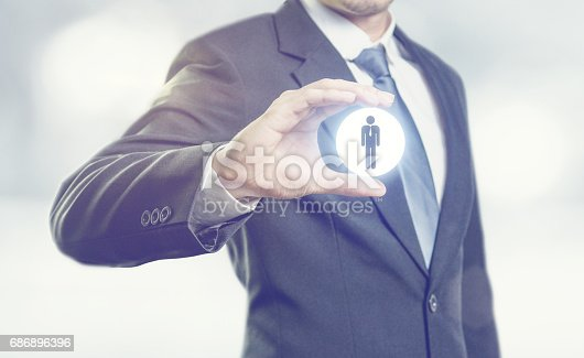 istock Businessman holding opinion leader, market leader, Leading concepts. 686896396
