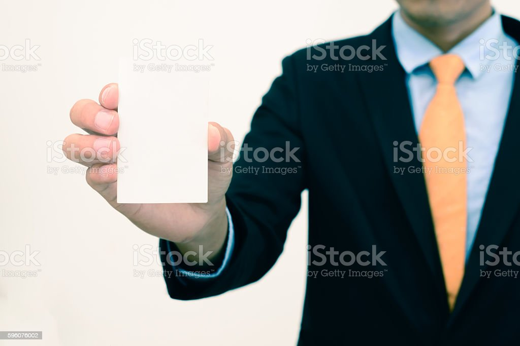 Businessman holding or showing blank business card isolate on white. royalty-free stock photo