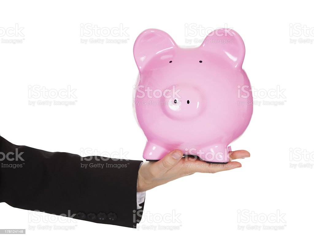 Businessman holding out a piggybank royalty-free stock photo