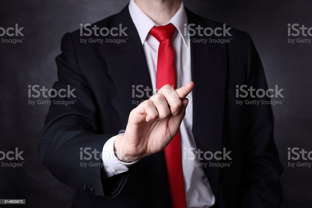 Businessman holding out his hand stock photo