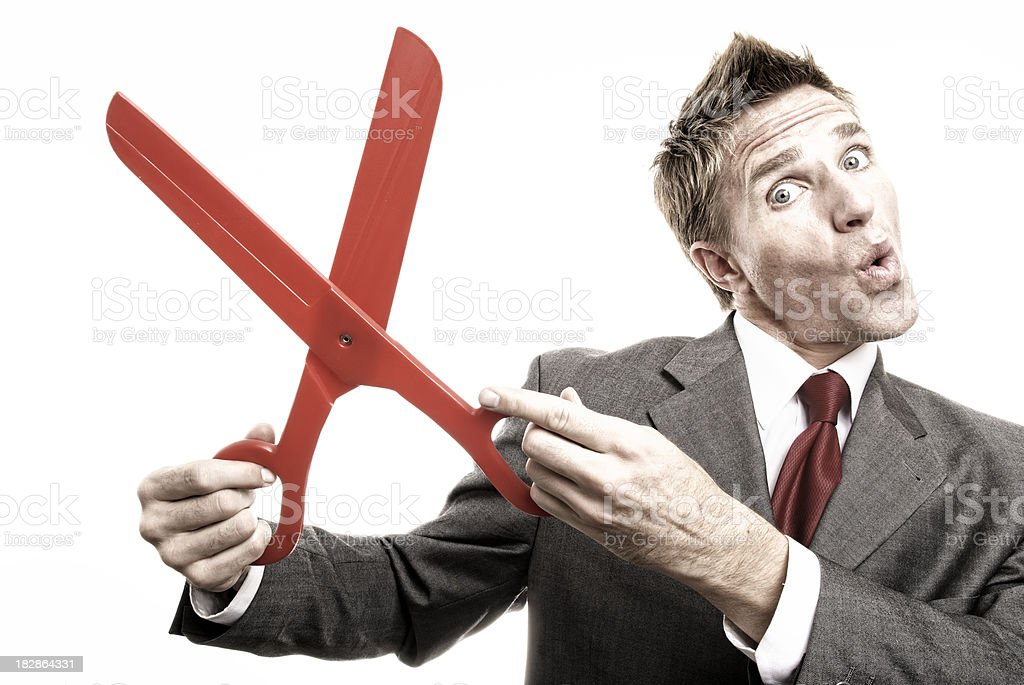 Businessman Holding Pair of Big Red Scissors Snip-Snip royalty-free stock photo